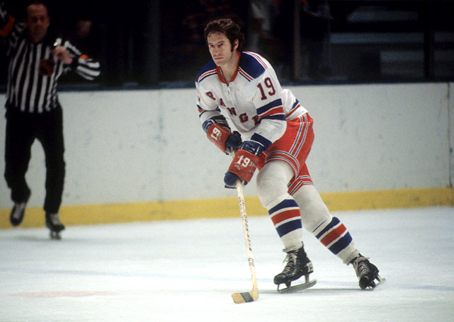 The man known as Gentleman Jean was as good a playmaking center as anyone in his era and he thrived at a time when non-physical players like him were targets for abuse. Ratelle, a Blueshirt for 14 full seasons, stands second in Rangers history in goals (336) and third in assists (481) and points (817). He was the centerpiece of the team's famed GAG (goal-a-game) line with Vic Hadfield and Rod Gilbert, and won the Masterton (1971) and Lady Byng (1972, '76) trophies as a Ranger. He was inducted into the Hockey Hall of Fame in 1985.