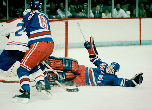 The goalie known as Beezer had a breakout Vezina Trophy-winning campaign in 1985-86 when he recorded all but five of the Rangers' 36 wins and led the team into the playoff semi-finals after upsets of rivals Philadelphia and Washington. He manned the Rangers' net for the first nine full seasons of his NHL career (1984-93), departing for Florida before New York's march to the Stanley Cup in 1994. He retired in 2002 with the most career wins, 374, of any U.S.-born goalie in league history.