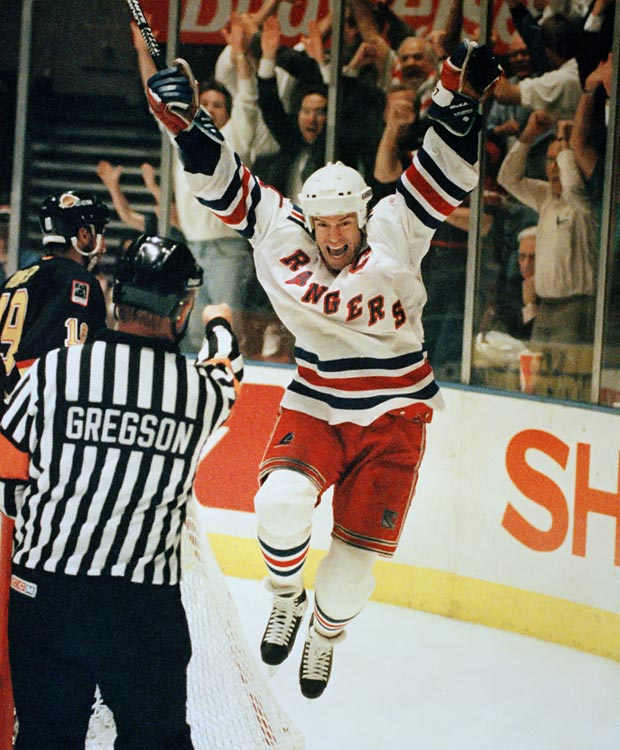 The man who promised a Stanley Cup for New York delivered it in 1994, producing a dramatic hat trick in a must-win Game 6 vs. New Jersey in the Eastern Conference Finals en route to ending New York's 54-year title drought. Messier, who hoisted five Cups with Edmonton, twice won the Hart Trophy as league MVP, including once with the New York in 1992. The Rangers retired his No. 11 in 2006 and he entered the Hockey Hall of Fame the following year.