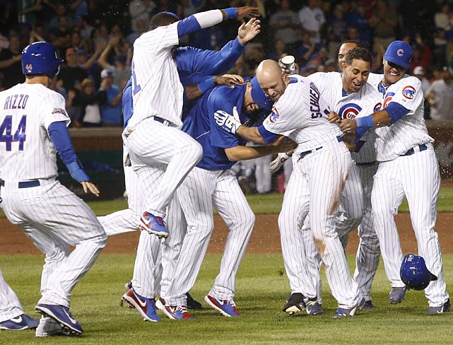 Nate Schierholtz celebrates with teammates after his walk-off RBI single scored Anthony Rizzo to beat the New York Mets on June 3.