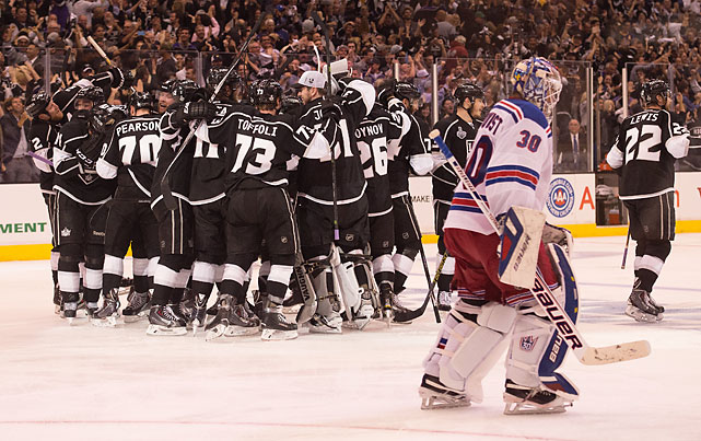 SI's best shots from Game 1 of the Stanley Cup Final in which the L.A.Kings won 3-2 in overtime, much to the chagrin of Rangers goaltender Henrik Lundqvist.