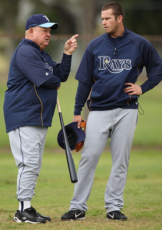 Zimmer gives third baseman Evan Longoria some pointers. He spent 11 years as part of the Rays, for whom he worked until his death.