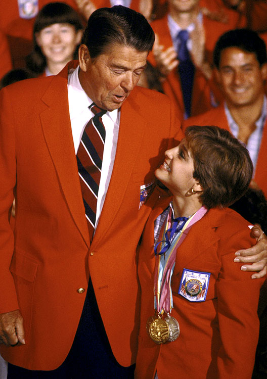 President Reagan poses with Olympic gold medalist in gymnastics, Mary Lou Retton, at a breakfast for U.S. Olympic athletes in Los Angeles.