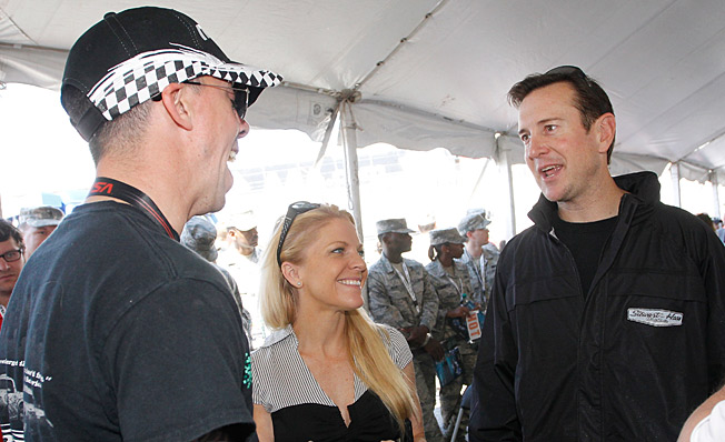 Kurt Busch (right) and girlfriend Patricia Driscoll met up with Marine Sgt. Liam Dwyer at Dover.