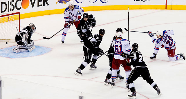 Jonathan Quick stops a shot by Chris Kreider.