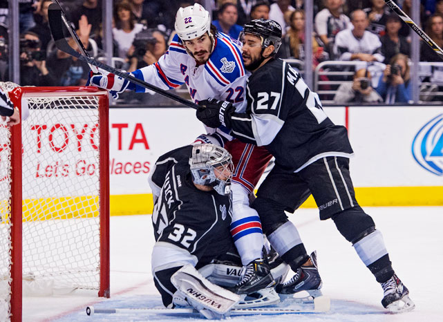 Brian Boyle collides with goaltender Jonathan Quick in the first period. The Rangers led 2-0 after that period.