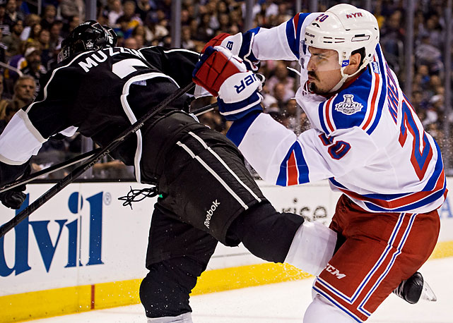 Chris Kreider of the checks Jake Muzzin.