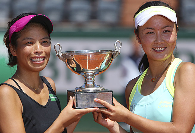 Taiwan's Su-Wei Hsieh (left) and China's Peng Shuai celebrate with their trophy after winning Women's doubles at the French Open.