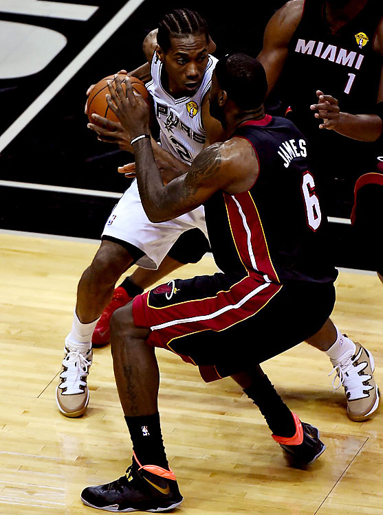 Leonard, being guarded closely here by James, missed six of his nine shots and finished with nine points.