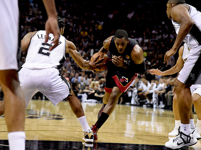 Mario Chalmers tries to drive the lane against the Spurs defense.