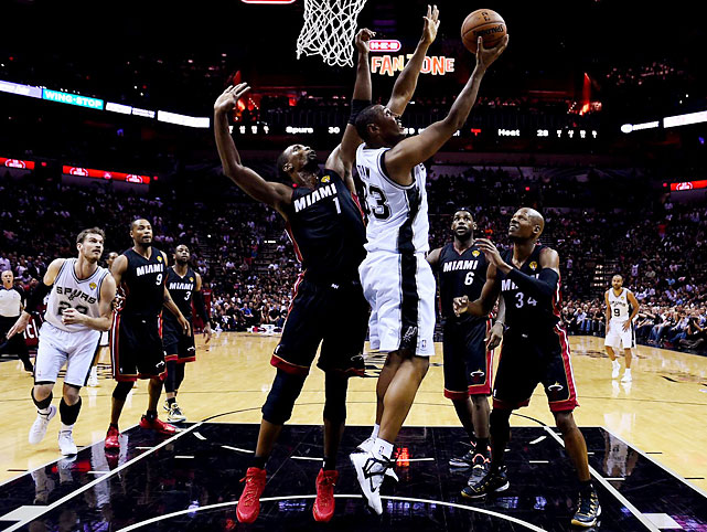 Boris Diaw maneuvers for a reverse layup against Chris Bosh. Diaw came off the bench to score seven points and grab 10 rebounds.