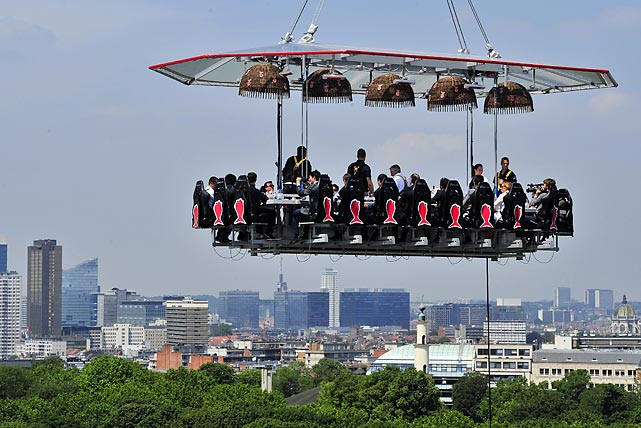 "In other culinary news, this eatery in (or more accurately, <italics>over</italics>) Brussels suspended operations so diners above the Parc du Cinquantenaire could partake of a ""unique occasion"" to discover the city's high cuisine and enjoy a spectacular view. The 22 guests were strapped into chairs around a mini kitchen where a ""starred"" chef rustled up the grub and vino. Brussels (home of the famous sprouts) wants to become a major actor on the European gastronomic scene. No word if grasshoppers and mealworms were on the menu."