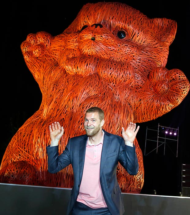 Giving us paws: Dutch artist Florentijn Hofman poses with his latest masterpiece made from strips of bamboo at Shanghai Design Week at Century Park in, of all places, Shanghai. The 10-meter high kitten isn't actually pink, but colorblind folks won't notice.