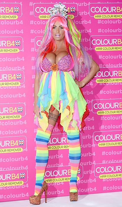"""According to the always entertaining and edifying <italics>Daily Mail</italics>, the former <italics>Glamour </italics>model was seen sporting a """"baby bump"""" in recent photos distributed by social media. Here she's seen sporting not one, but two baby bumps and what the Mail called """"a truly bizarre multicoloured outfit"""" during a photo shoot for her role as Global Ambassador for ColourB4 at London't Worx Studio."""