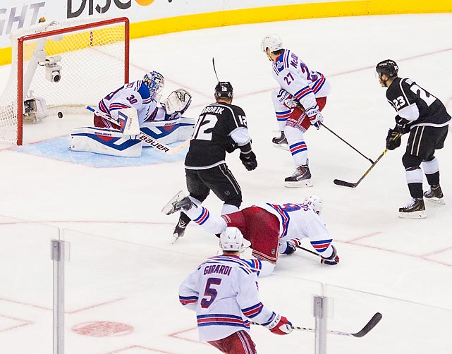 In even more foodstuffs news, when this black biscuit eluded Rangers netminder Henrik Lundqvist and ended up in his basket in double OT, New York's finest found themselves in a two-games-to-none hole against the Los Angeles Kings as the teams battled for the right to hoist Lord Stanley's famous old soup tureen.