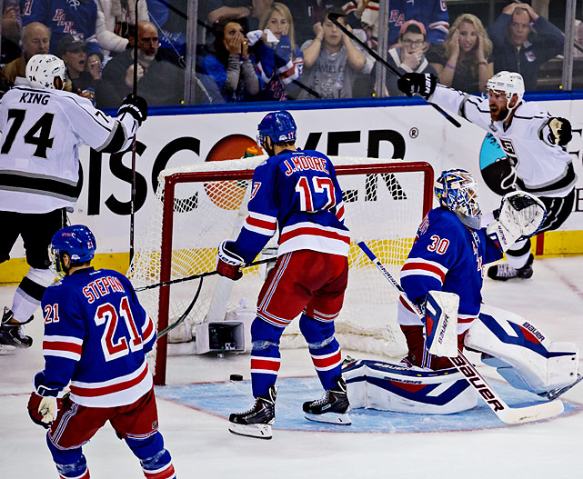 Los Angeles took its first in-game lead in the series when Jeff Carter (right) scored on Los Angeles' fifth shot. Carter came in and snapped a hard drive that clipped the skate of diving defenseman Dan Girardi in front of Henrik Lundqvist and caromed inside the right post with 0.7 seconds on the clock.