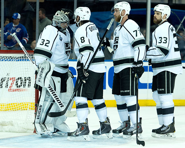 Jonathan Quick gets congrats from Drew Doughty and others after his superb game.