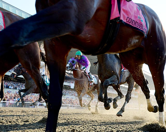 California Chrome (center) heads to the finish line at the Belmont Stakes. The Kentucky Derby and Preakness champ would finish fourth, unable to claim the Triple Crown.