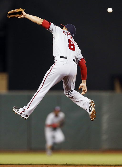 Washington Nationals second baseman Danny Espinosa fails to snag a line drive against the San Francisco Giants.