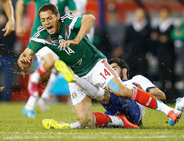 "Javier ""Chicharito"" Hernandez receives a hard foul from Portugal's Neto during an international friendly at Gillette Stadium in Foxboro, Mass."