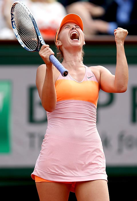 Maria Sharapova celebrates a point during thesingles final against Simona Halep at the French Open in Paris.