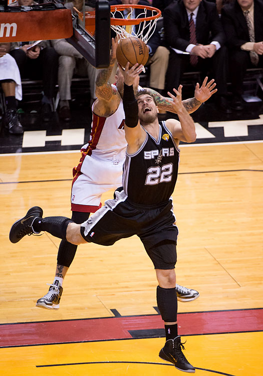 Tiago Splitter finishes a reverse layup for two of his six points. Under coach Gregg Popovich, the Spurs have won 15 of the 18 best-of-seven series in which they led 2-1.