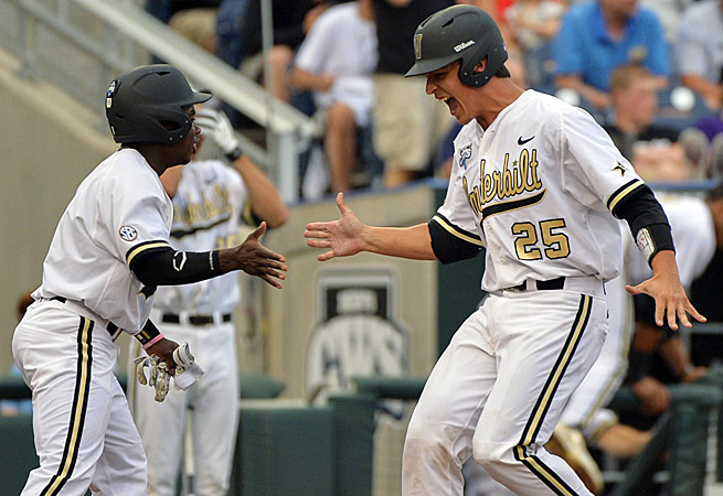 Vanderbilt's Karl Ellison (25) is greeted by teammate Ro Coleman after scoring on a two-run double.