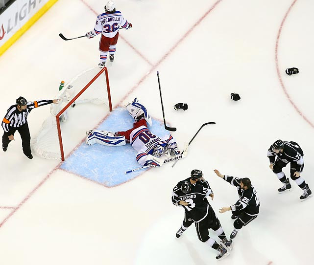 King Henrik lies vanquished as the Los Angeles Kings celebrate their chalice-winning goal in double overtime of Game 5 at Staples Center.