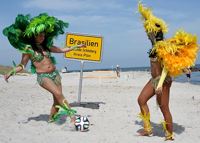 Brazilian dancers Luciana (left) and Simone get their kicks on the WC Beach, which is actually in northern Germany. The big soccer tournament that everyone's getting all worked up about is being played 5,800 miles away in Brazil.