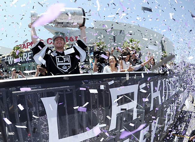 Goalie Jonathan Quick holds the silverware aloft as the Kings of the NHL reign for the second time.