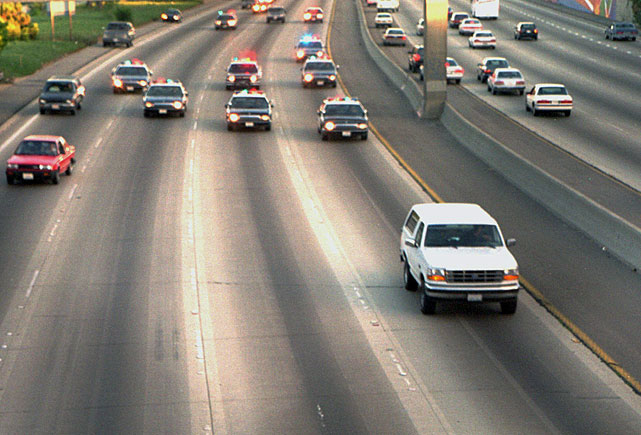 On June 17, 1994, in one of the most memorable events in modern history, O.J. Simpson led police on a 50-mile, low-speed chase down Interstate 405 in Los Angeles. Simpson, who was accused of double-murder, was a passenger in a white Ford Bronco driven by former teammate Al Cowlings. The chase, which was watched by a reported 95 million viewers, finally ended when Simpson returned to his Brentwood home. Here are some scenes from that unforgettable day, 20 years later.