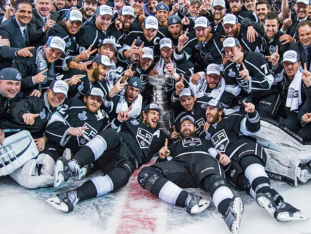 The newly-crowned Los Angeles Kings pose for the traditional team picture with the Stanley Cup to celebrate their championship.