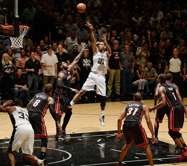 Tim Duncan of the San Antonio Spurs fades away for a shot over Miami's LeBron James in San Antonio's Finals-clinching 104-87 Game 5 win. The seemingly ageless Duncan took home his fifth championship win as a Spur, also the fifth in franchise history.