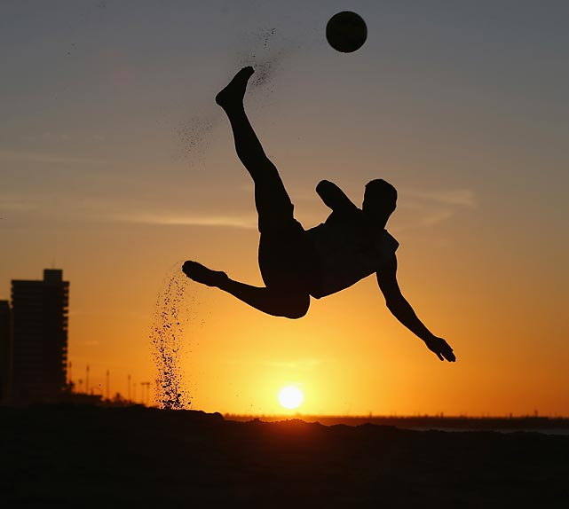 A soccer player shows off his beach football skills in Fortaleza, Brazil.