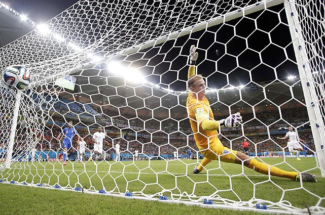 England goalkeeper Joe Hart fails to stop what would be the game-winning goal by Italy's Mario Balotelli in their World Cup opener. Balotelli's shot gave Italy a 2-1 win.