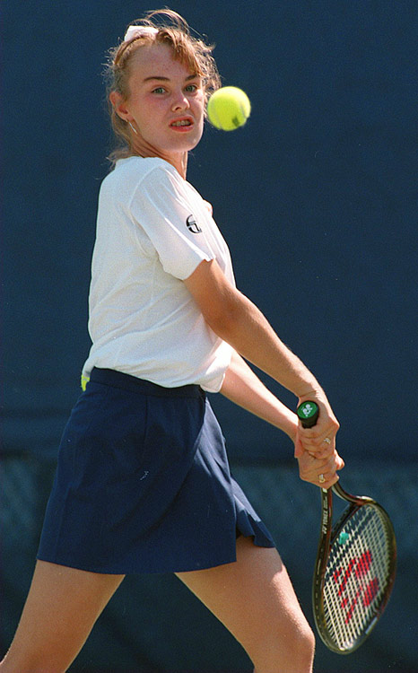 Age: 14 years and 10 days |                                      The daughter of two professional tennis players, Hingis burst onto the scene at a young age, and also became the youngest player to win a Grand Slam match with a first-round win at the 1995 Australian Open. She went on to win five Grand Slam singles titles and nine Grand Slam women's doubles titles.