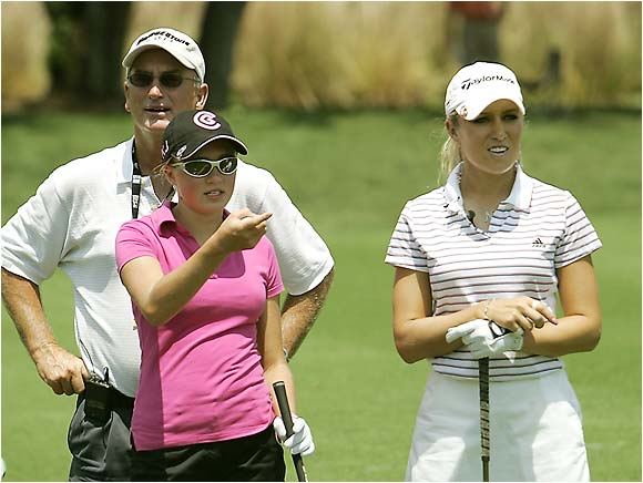 """Dakoda asks for tips (or was she giving them?) from playing partner Natalie Gulbis during her practice round. """"She's such a good kid,"""" said her other playing partner, Paula Creamer. """"She's fearless on the golf course. She just steps up and hits it and hits it again. I couldn't even imagine what that whole family is going through."""""""