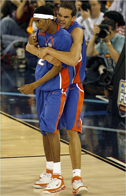 Joakim Noah and Corey Brewer celebrate their 20-point lead in the second half.