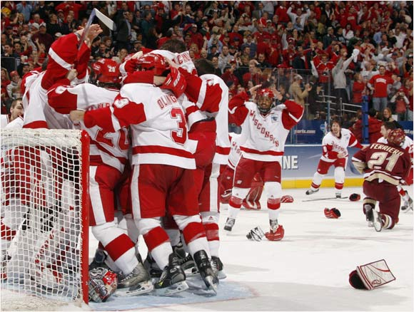 Wisconsin players celebrate their school's sixth national hockey championship, a 2-1 victory over Boston College at the Bradley Center.
