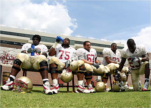 Florida State University players rest on the sideline during the Garnet and Gold Spring Football Game in Tallahassee.