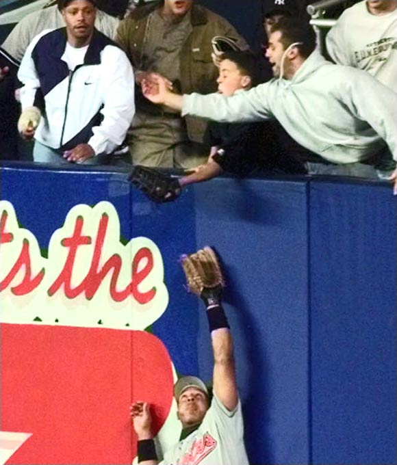 Twelve-year-old Jeffrey Maier created a game-tying homer by Derek Jeter in the eighth inning of Game 1 of the ALCS when he reached out of the stands and grabbed a ball that was about to be caught by Tony Tarasco. Bernie Williams homered in the 11th to give New York a 5-4 victory.