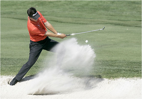 New Zealand's Phil Tataurangi blasts out of a sand trap on the 18th hole at the Byron Nelson Championship.