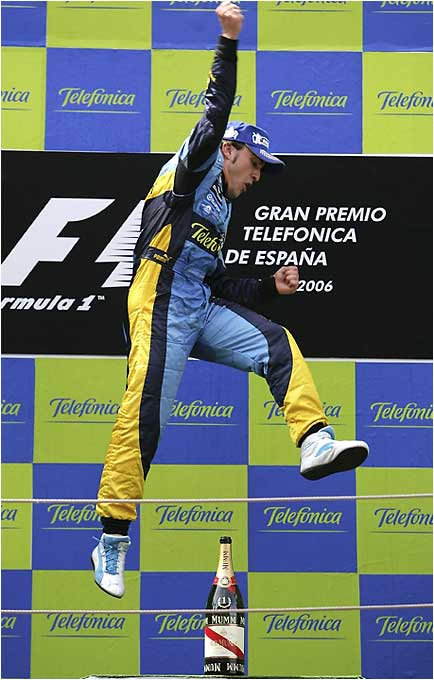 F1 points leader Fernando Alonso celebrates his victory at the Spanish Grand Prix. Alonso is the first Spaniard to win the event.