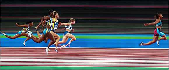 Marion Jones puts on a gold-medal-winning performance in the 100-meter dash at the 2000 Summer Olympics in Sydney.