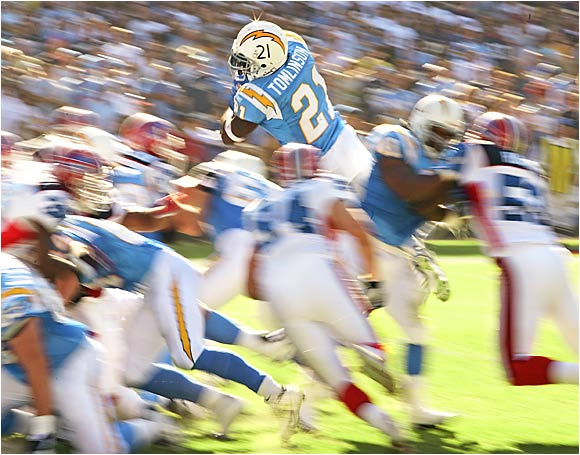Since 2000, Sports Illustrated has won a bevy of prestigious photo awards, some for shots taken by staff photographers and others for photos taken by freelancers. Here's a sampling.San Diego Chargers running back LaDainian Tomlinson leaps toward the end zone in a game against the Buffalo Bills.