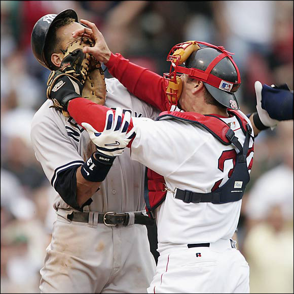 Red Sox captain Jason Varitek didn't appreciate Alex Rodriguez's staring down Red Sox starter Bronson Arroyo after getting hit by a pitch. Varitek and A-Rod squared off, with Varitek shoving the Yankees star in the face. Both dugouts and bullpens emptied, and both players were ejected. The inspired Red Sox rallied to win the game on Bill Mueller's ninth-inning homer off Mariano Rivera.