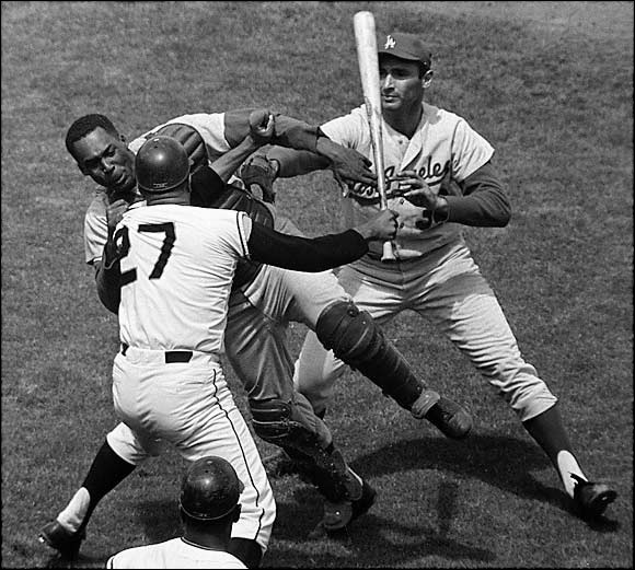 The Giants and the Dodgers were bitter rivals engaged in a pennant race when Juan Marichal came up to bat against Sandy Koufax. When Dodgers catcher Johnny Roseboro threw a ball back to Koufax that nicked Marichal's ear, the San Francisco ace struck the catcher with his bat, setting off a melee and opening a two-inch gash on Roseboro's head. Marichal was suspended nine days and fined $1,750.