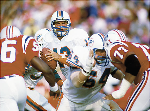 In just his second season, Dan Marino set single-season records for most yards (5,084), touchdown passes (48) and completions (362) as the Dolphins passed their way to a 14-2 record and a trip to the Super Bowl, where they lost to the 49ers. Opponents knew the Dolphins were going to throw often, but thanks to an outstanding offensive line and Marino's quick release, Miami could not be stopped.