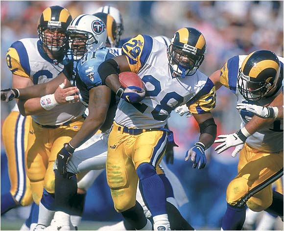 "The ""Greatest Show on Turf"" was brilliant from 1999 through 2001, and it's difficult to choose one year out of the three as the ultimate Rams offense. But the Rams won the Super Bowl in 1999, and that's when the NFL first realized that stopping St. Louis was virtually impossible. Third-string QB Kurt Warner came out of nowhere to throw 41 touchdowns, and the brilliant Marshall Faulk ran for 1,381 yards and had 1,048 yards receiving."