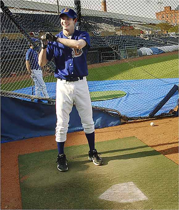 J.J. Redick takes batting practice in a Durham Bulls uniform before throwing out the first pitch.